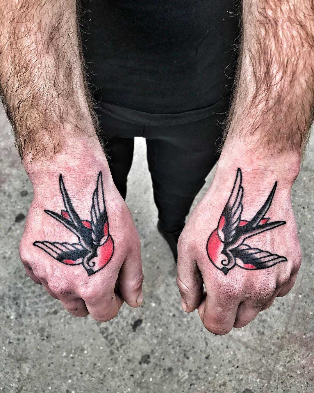 Matching swallow tattoos by Mike Nofuck