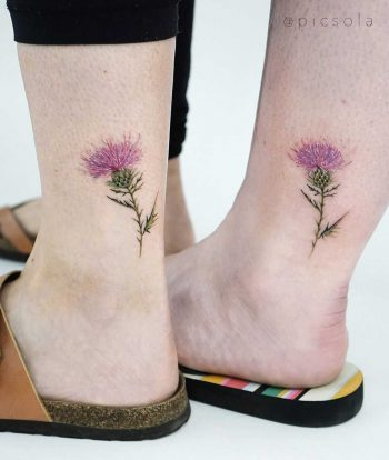 Matching thistle tattoos by tattooist picsola