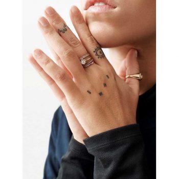 Minimalist finger tattoos by Zaya Hastra