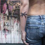 Minimalist palm tree tattoo by Remy B