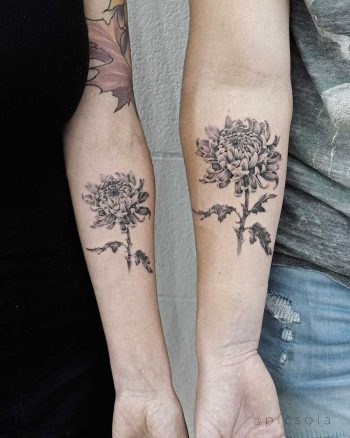 Mom and son matching flower tattoos by tattooist picsola