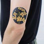 Mustard flowers tattoo by tattooist picsola
