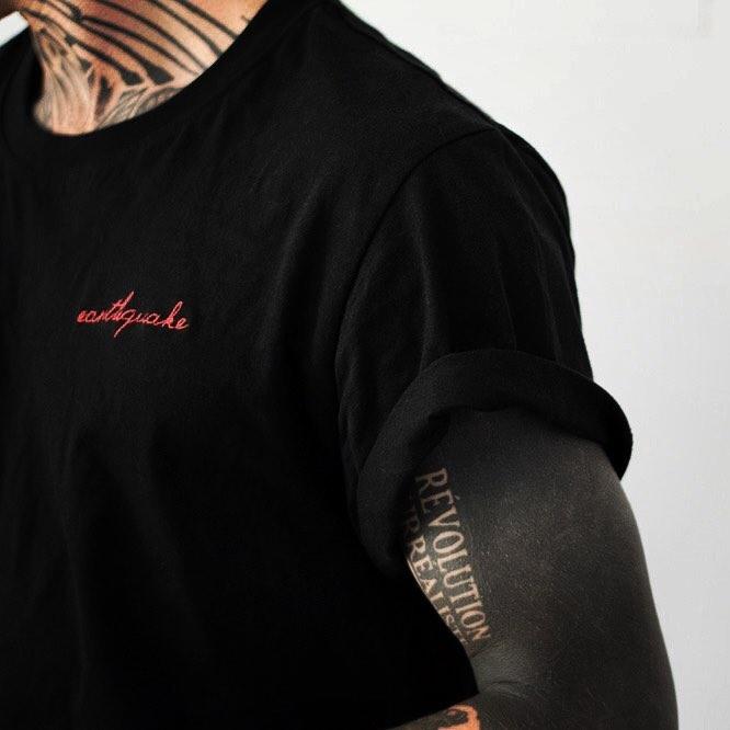 Negative space words sleeve tattoo by Philipp Eid