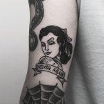 Never again tattoo by Krzysztof Szeszko