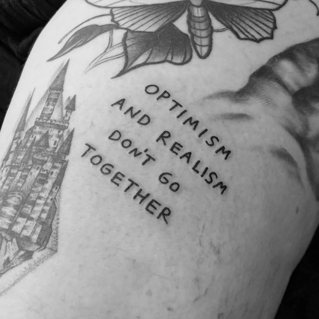Optimism and realism by tattooist Terrible Terrible