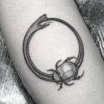 Ouroboros and scarab tattoo by Lozzy Bones