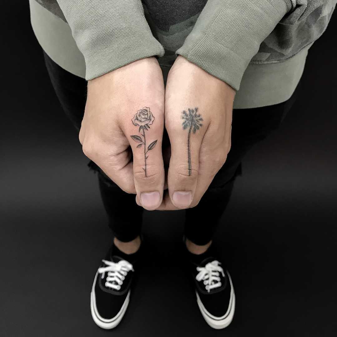 Palm tree and rose tattoos byJakub Nowicz