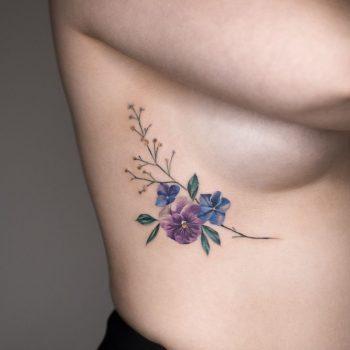 Pansy, Hydrangea, and Baby's-breath tattoo by Rey Jasper