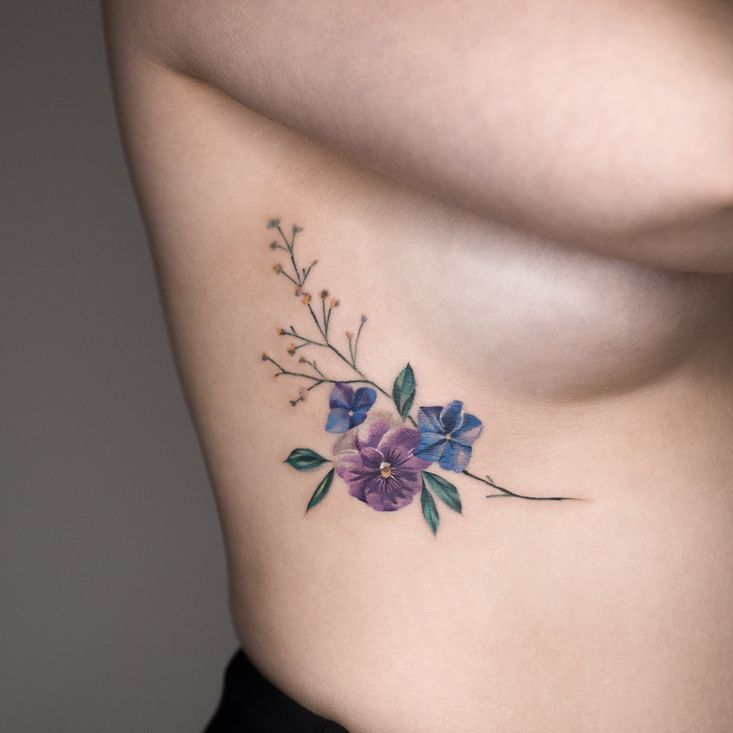 Pansy, Hydrangea, and Baby's-breath tattoo by Rey Jasper