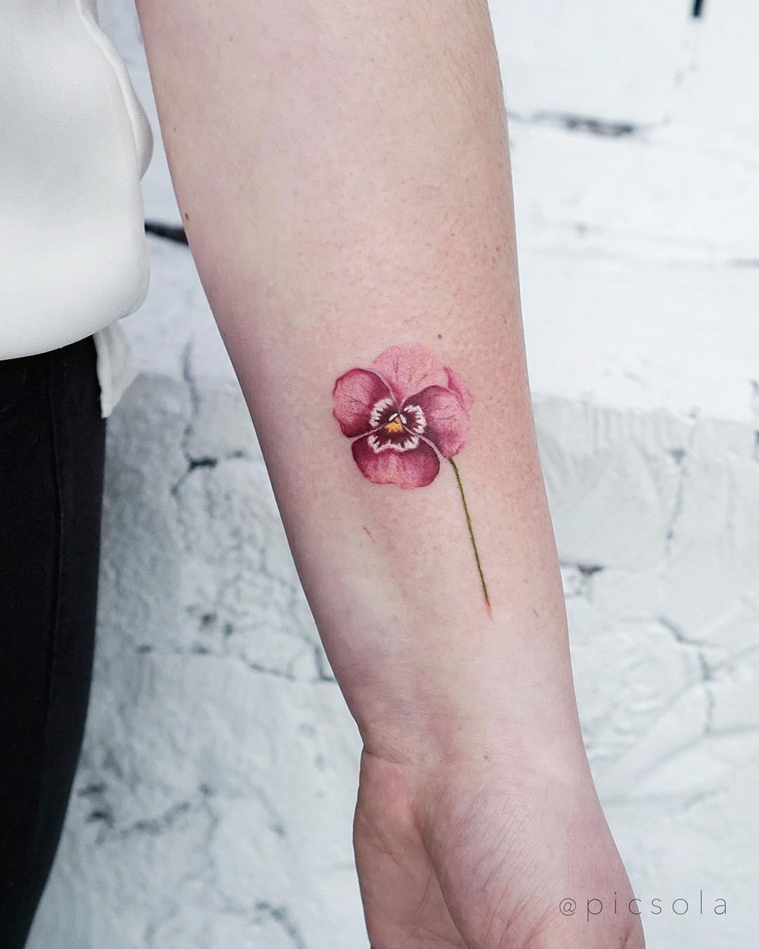 Pink pansy tattoo by tattooist picsola