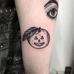 Pumpkin satsuma eye tattoo by Deborah Pow
