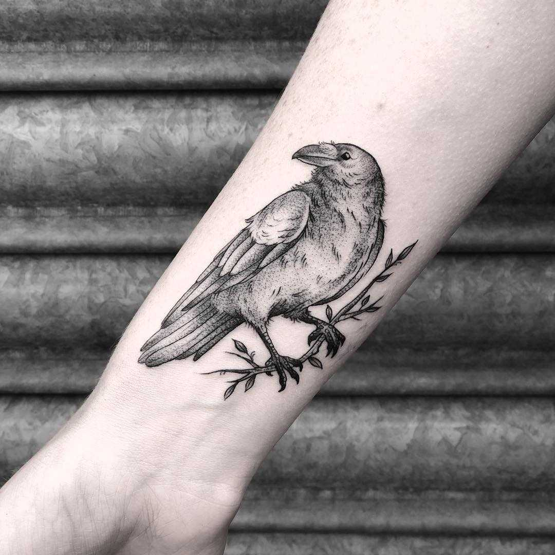Raven tattoo by Lozzy Bones