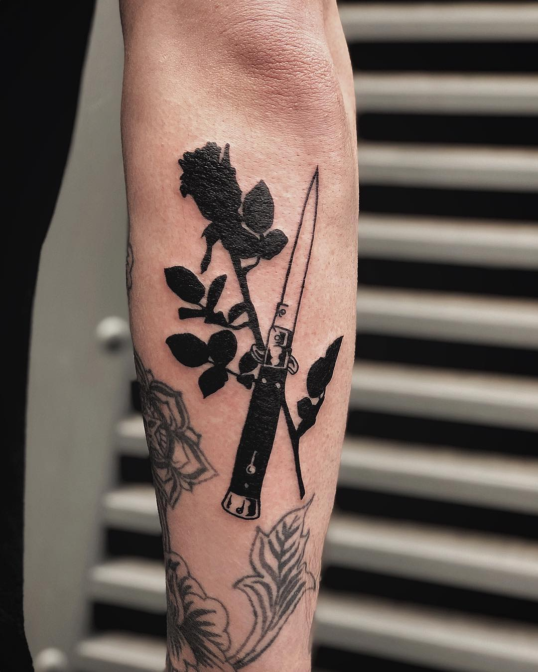 Rose and butterfly knife by Loz McLean