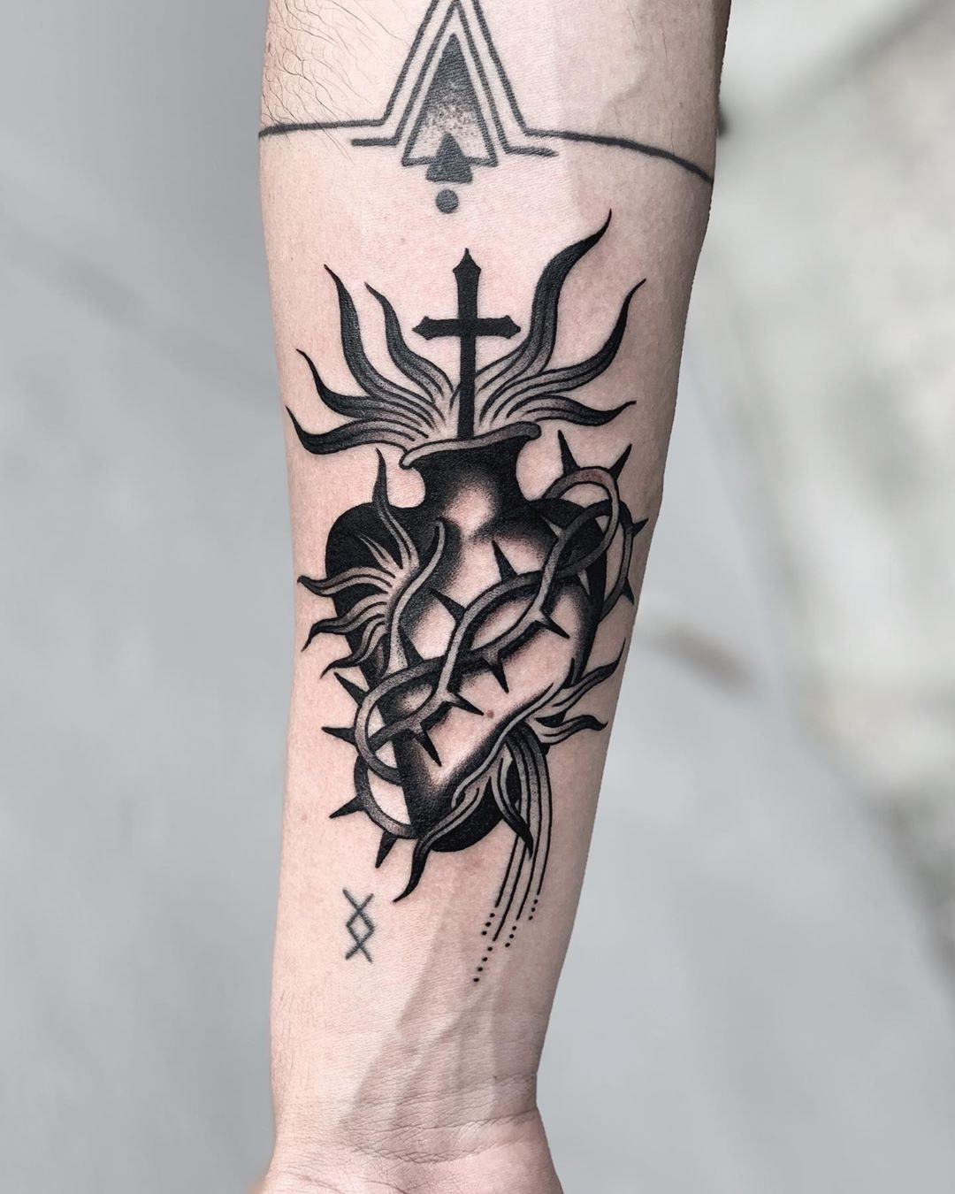 Sacred heart on a forearm by Javier Betancourt