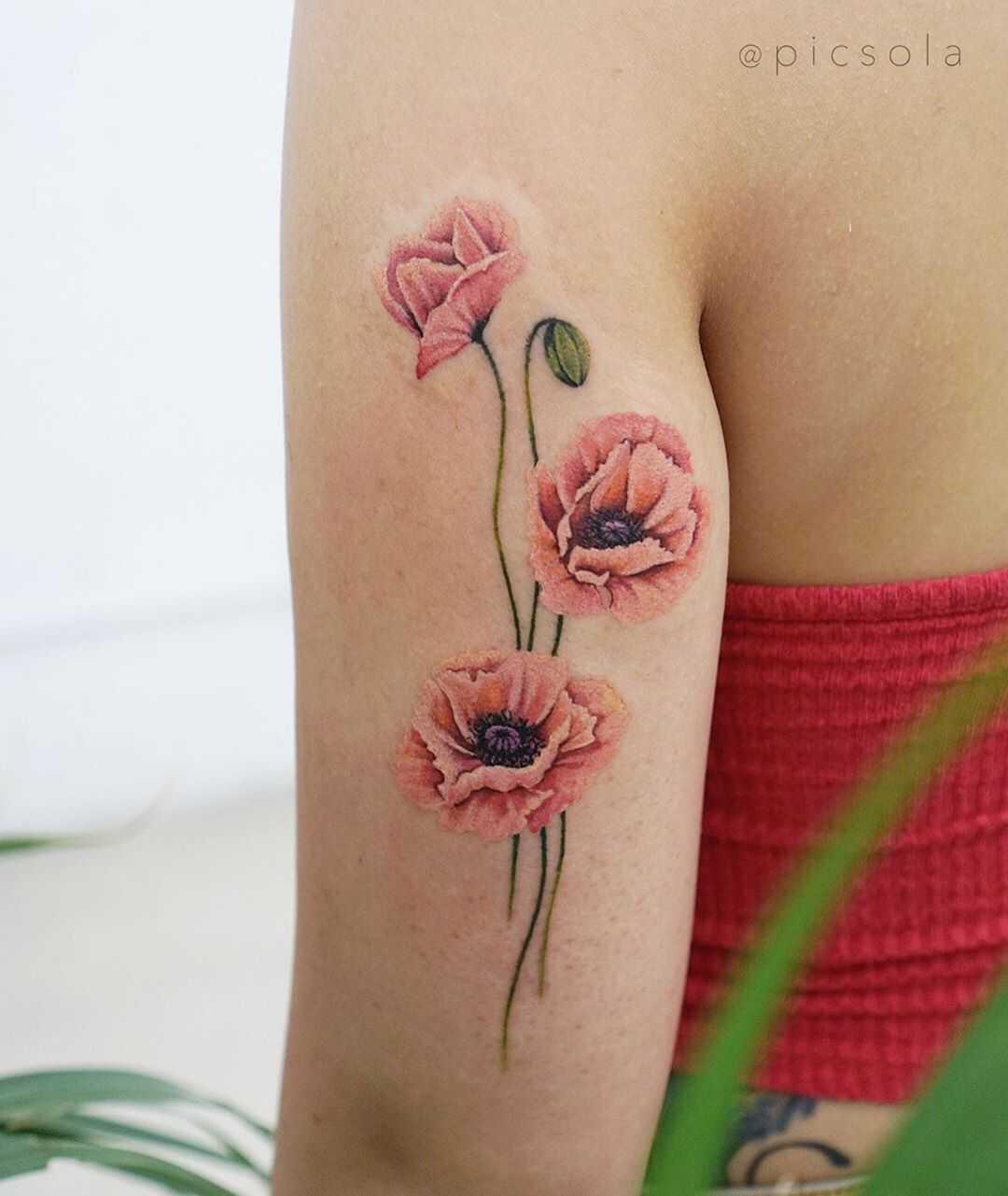 Salmon poppies tattoo by tattooist picsola