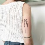 Simple spring stems tattoo by Kelli Kikcio