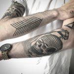 Skull and arrow feather tattoo by Jaya Suartika