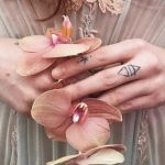 Small tattoos on fingers by Stanislava Pinchuk