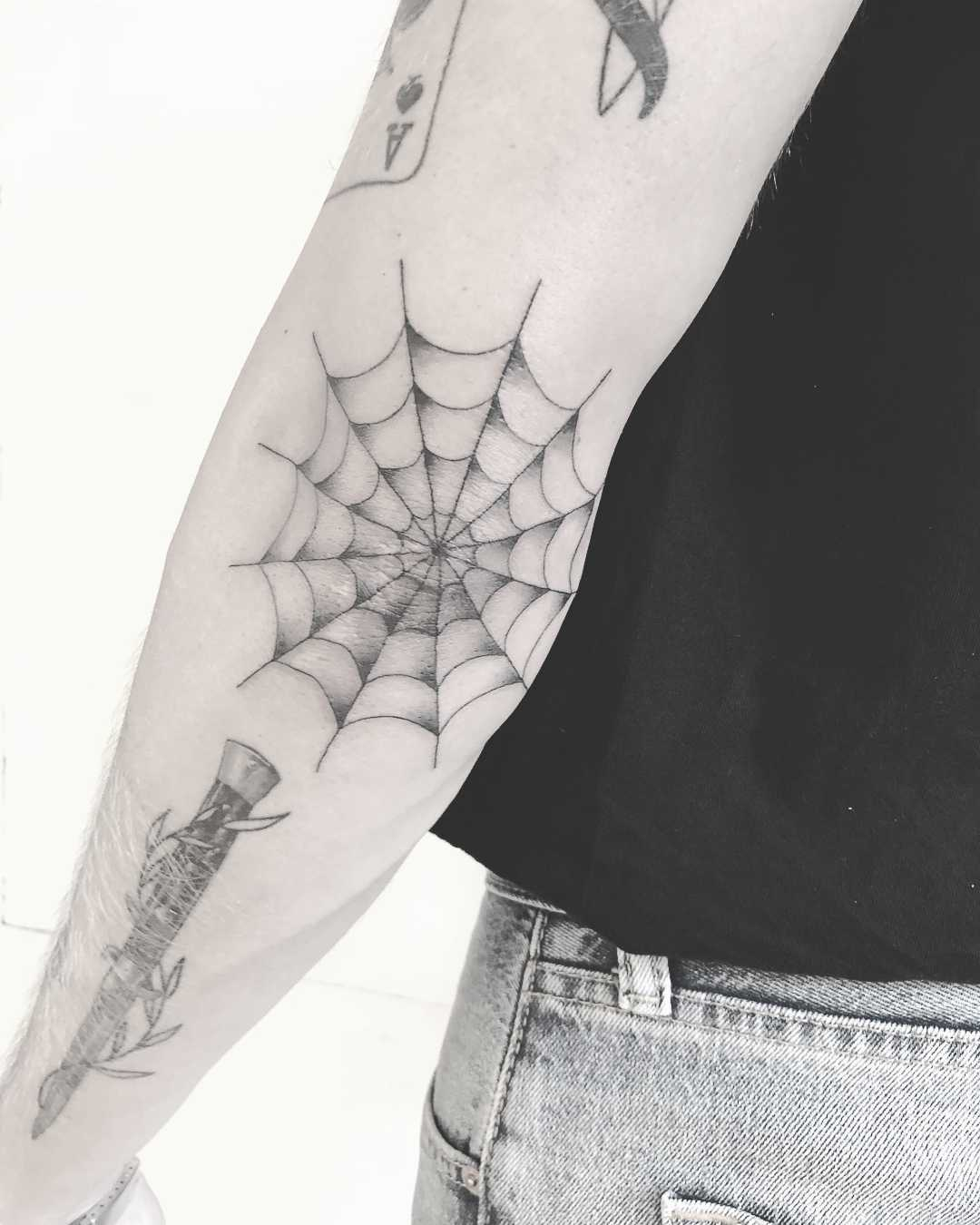 Spider web tattoo by Annelie Fransson