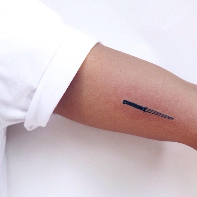 Super tiny knife tattoo by Kelli Kikcio