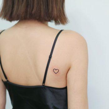 Tiny heart on the back by tattooist Nemo