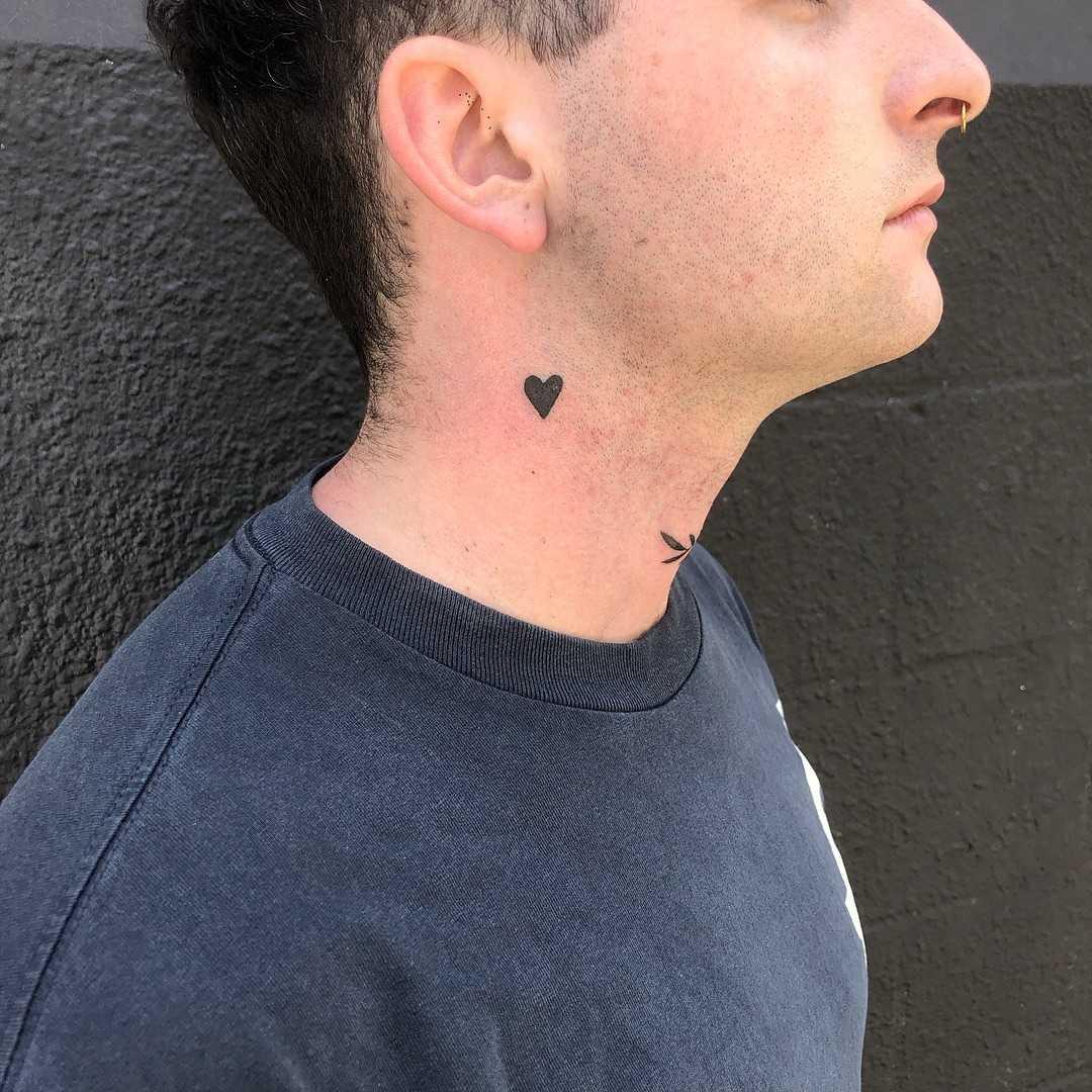 Tiny heart tattoo by yeahdope