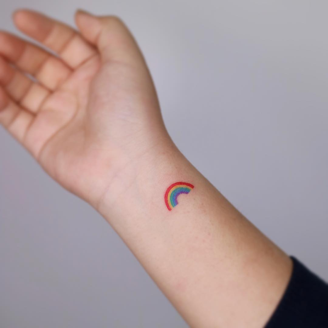 Tiny rainbow tattoo by tattooist Nemo