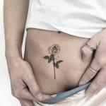 Tiny rose by tattooist Spence @zz tattoo
