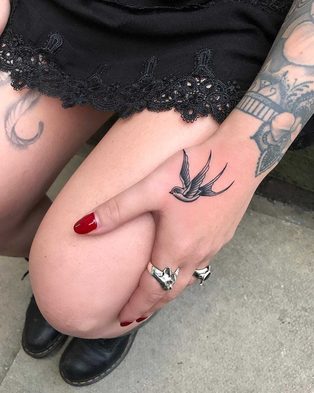 Tiny swallow on a hand by Matt Stopps