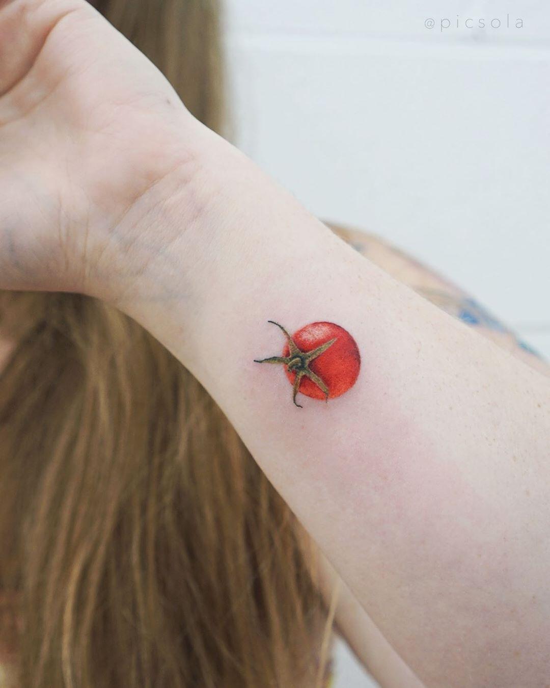 Tiny tomato tattoo by tattooist picsola