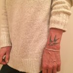 Traditional swallow on the wrist by Kirk Budden