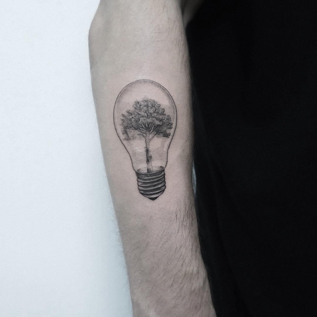 Tree in a light bulb by Jakub Nowicz