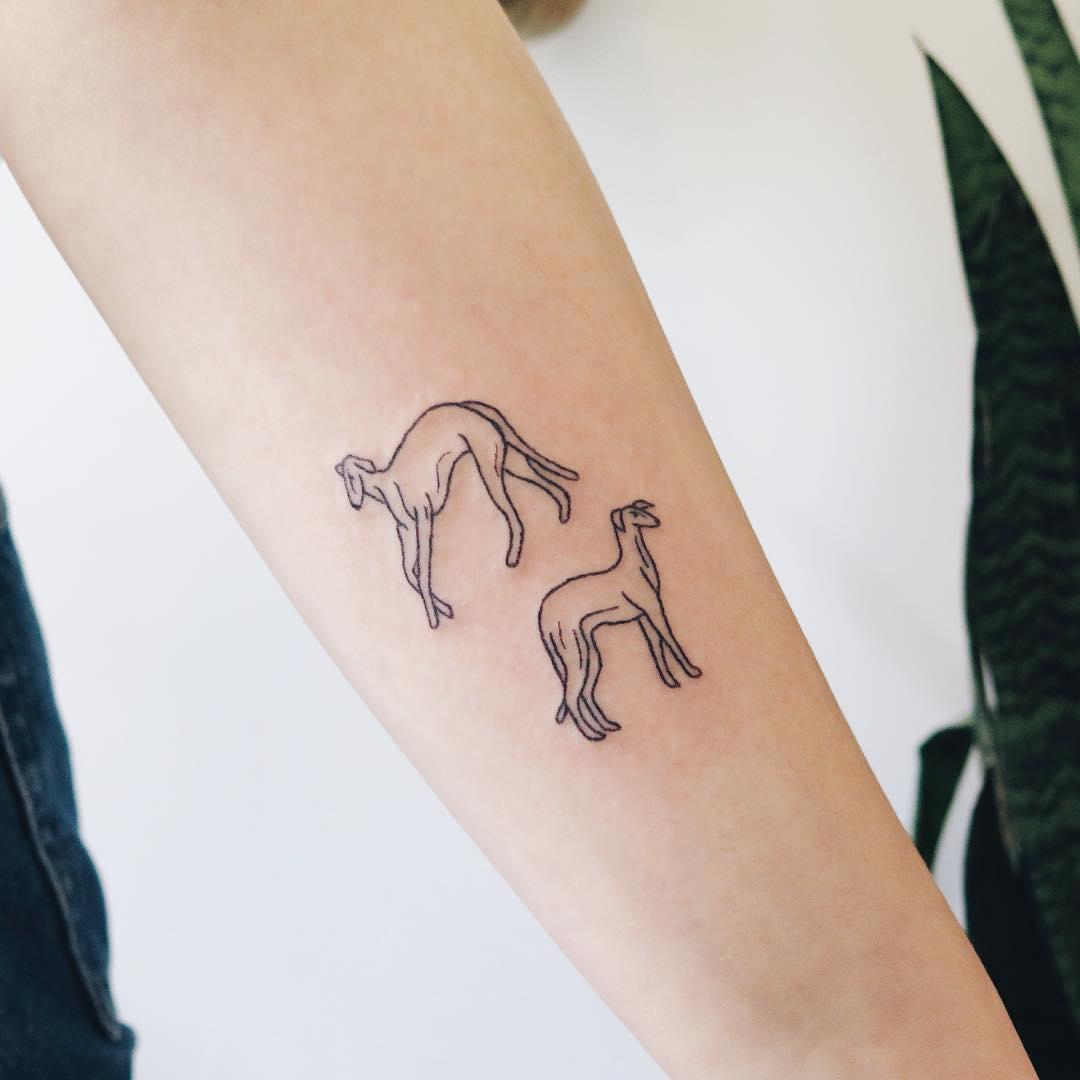 Two hounds by Kelli Kikcio