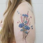 Wild flowers tattoo by tattooist picsola