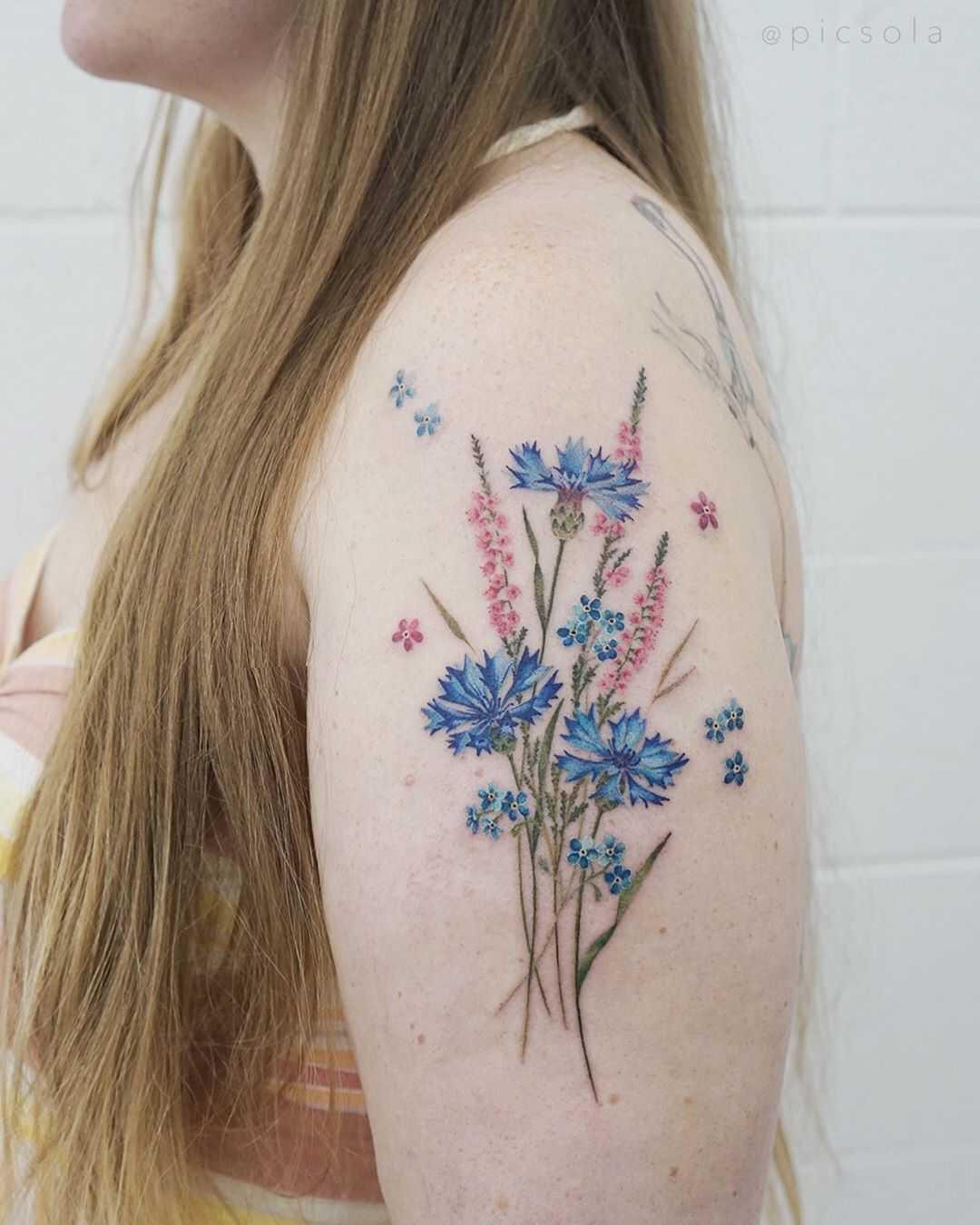 Wild flowers tattoo by tattooist picsola