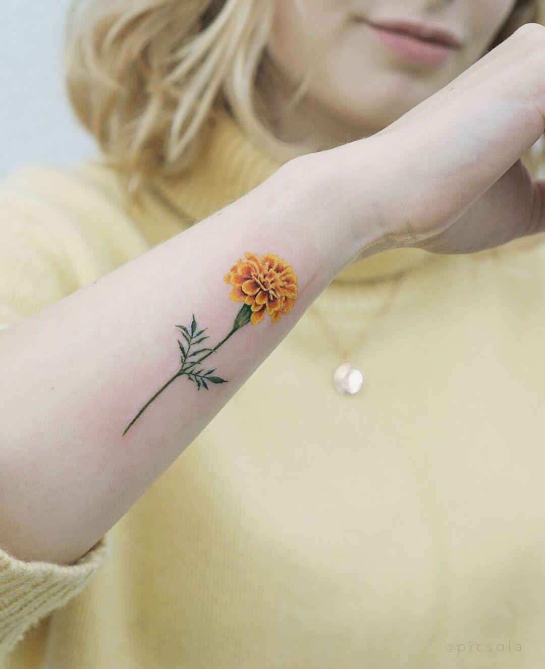 Yellow Marigold tattoo by tattooist picsola