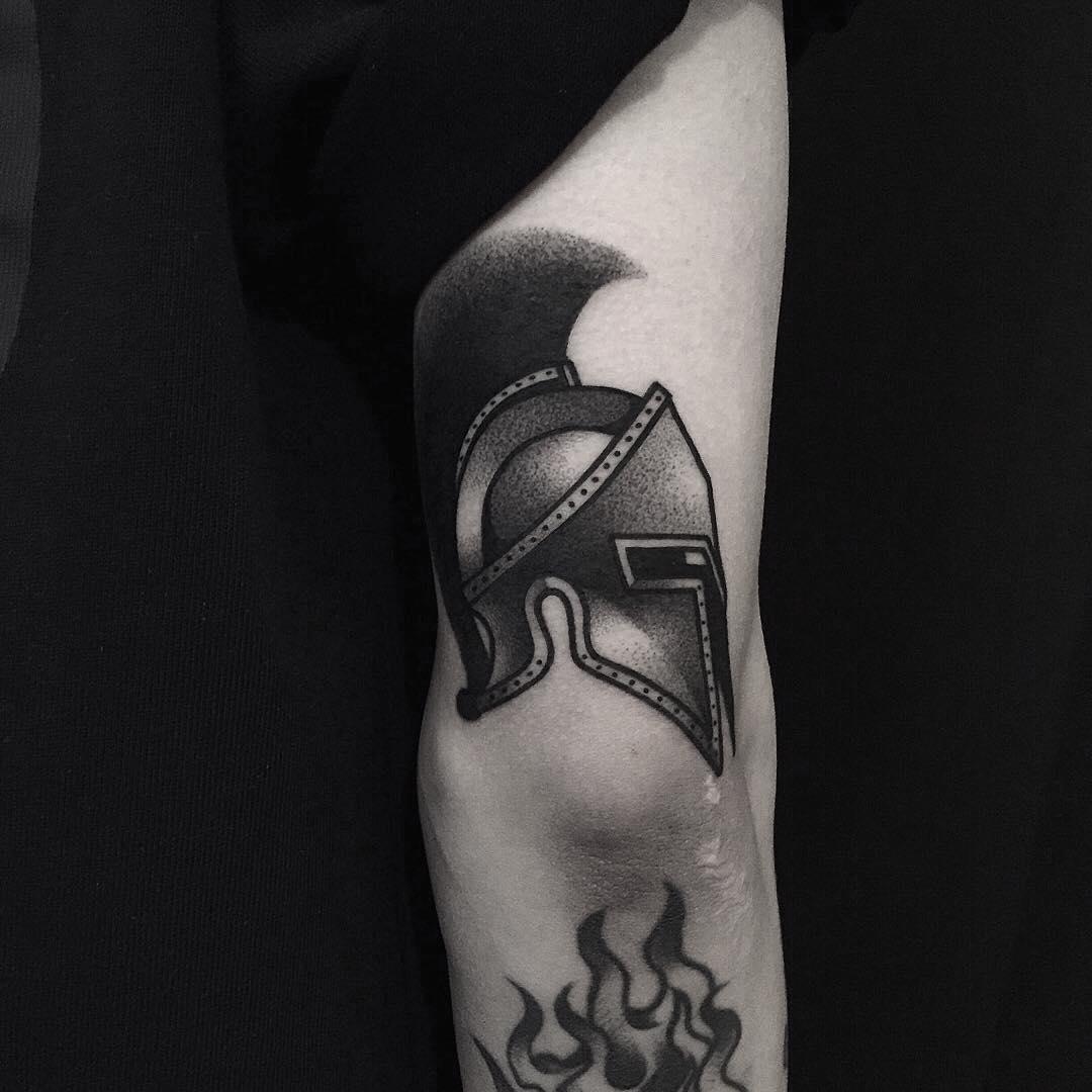 A black helmet tattoo by tattooist yeontaan