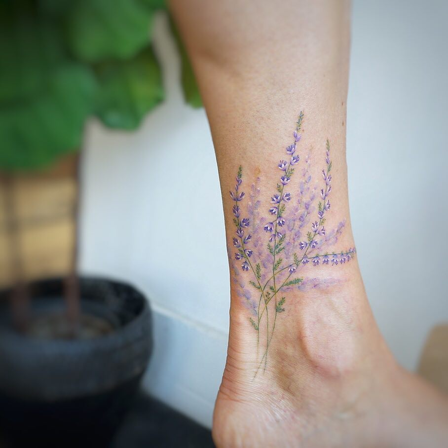Ankle flowers by tattooist G.NO