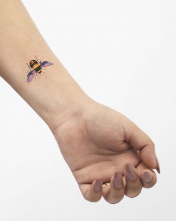 Bee tattoo on a wrist by Rey Jasper