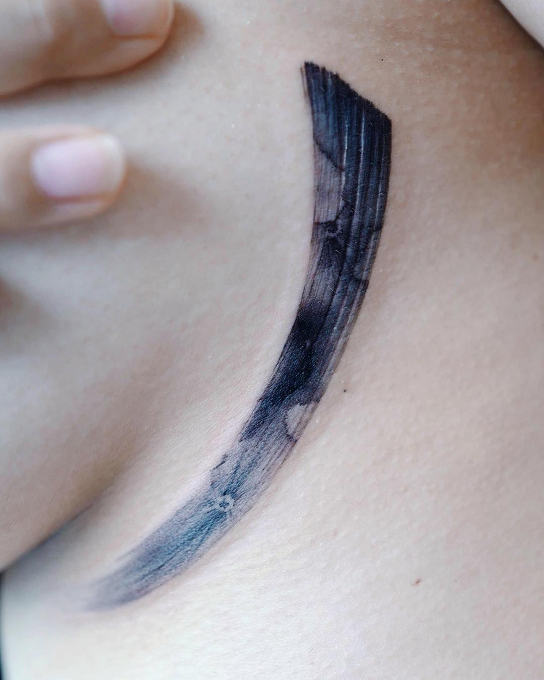 Brush stroke moon tattoo by Studio Bysol