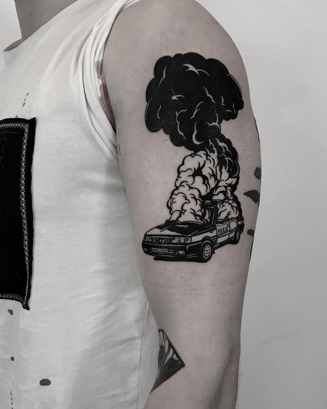 Burning car tattoo by Krzysztof Szeszko