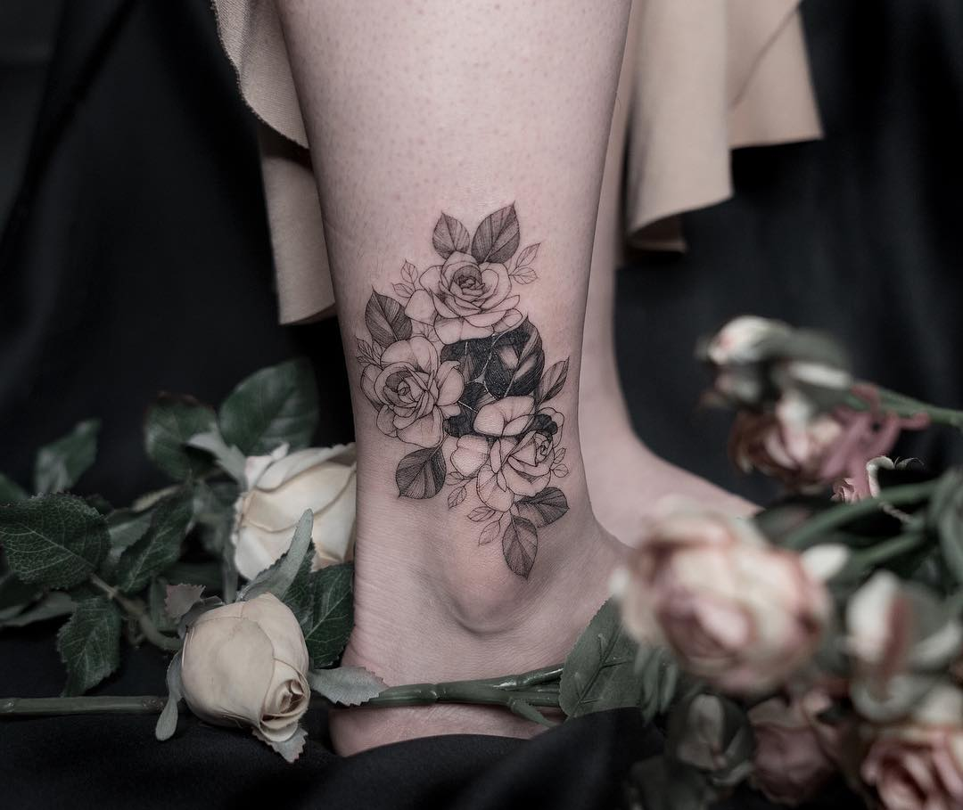 Cover-up flowers by tattooist Goyo