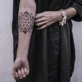 Fineline mandala tattoo by Remy B