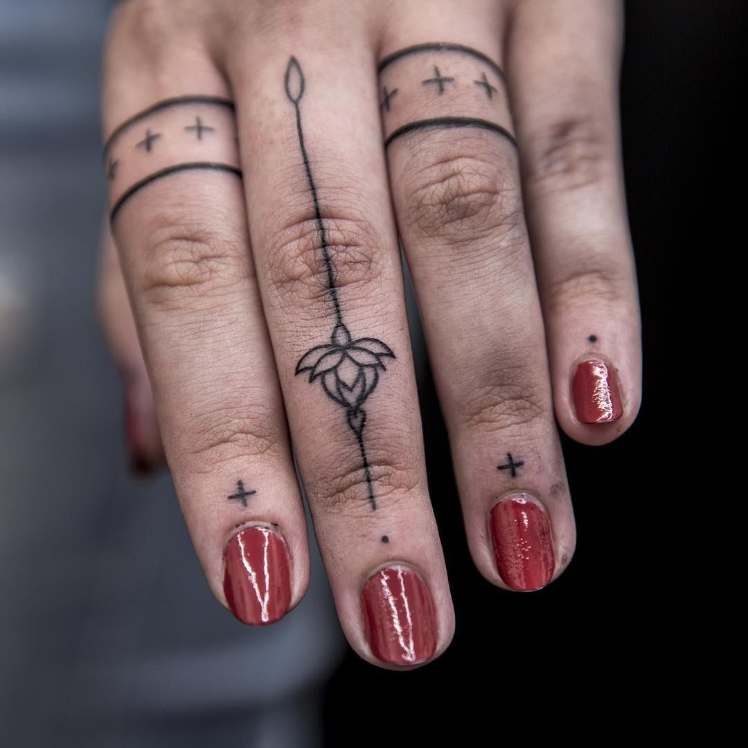 Finger tats by Remy B