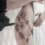 Floral hip piece by tattooist Goyo