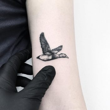 Flying goose tattoo by Loughie Alston
