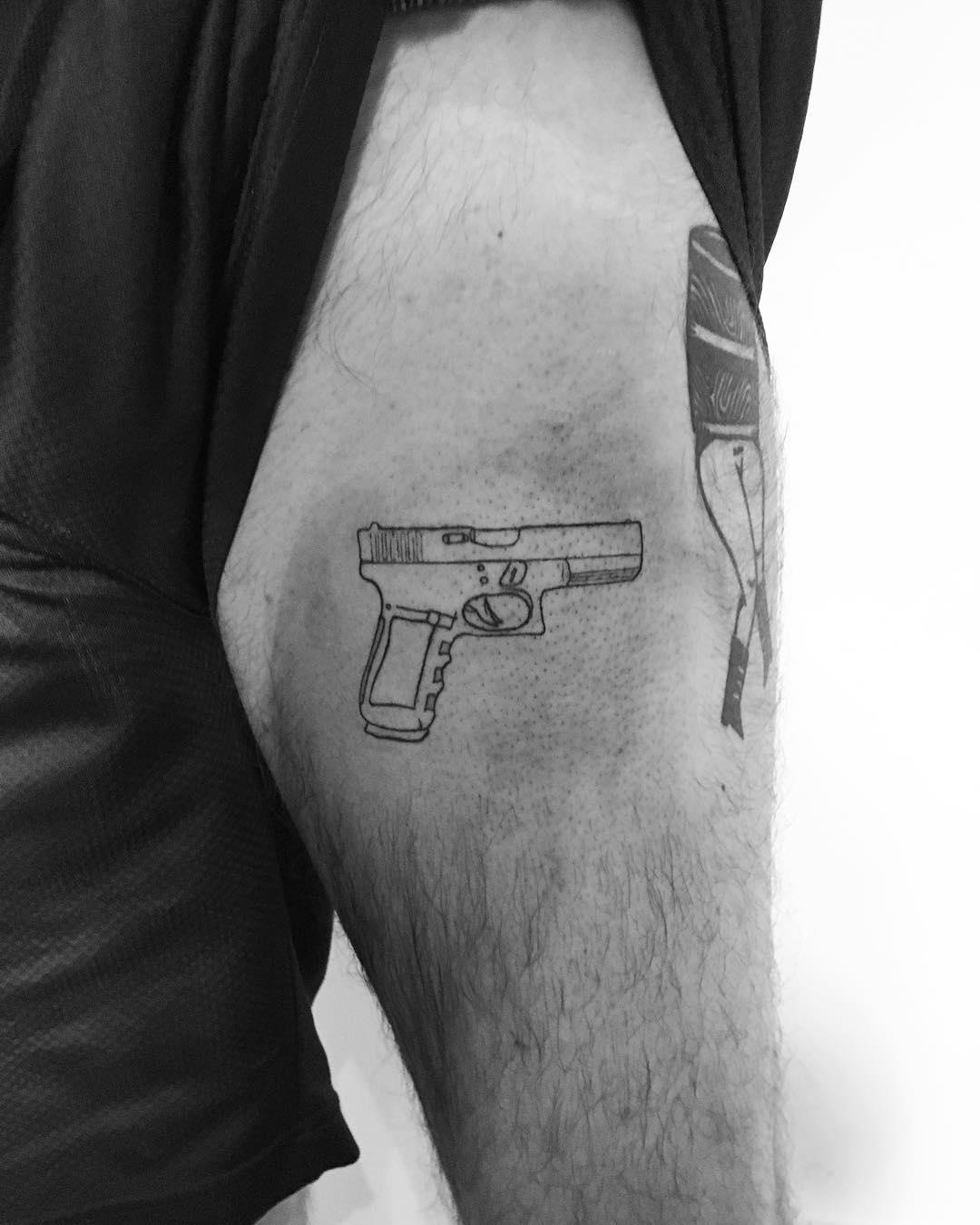 Glock tattoo by Philipp Eid