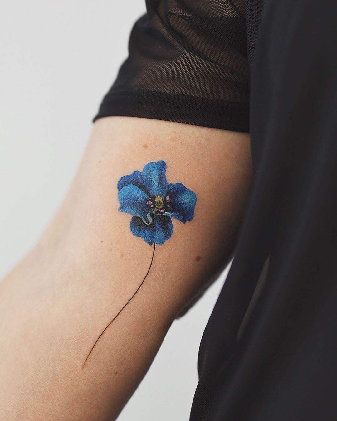 Himalayan blue poppy tattoo by Rey Jasper