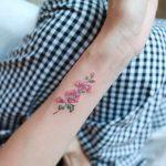 Hollyhock tattoo by tattooist Nemo