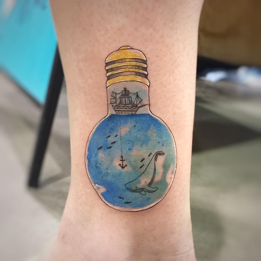 Light bulb with a sea inside by tattooist G.NO